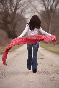 woman walking down road billowing red shawl A Roadmap for Women Planning for Retirement